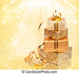 Gift box in gold wrapping paper on a beautiful abstract...