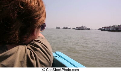 Female tourist traveling by boat