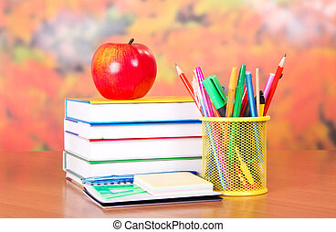 Pile textbooks and set of ball pens - Books, apple, pencils...