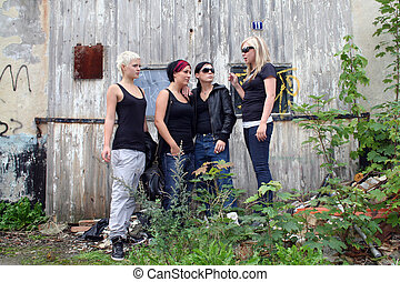 Girl gang - four girls hanging out lokking a little tough