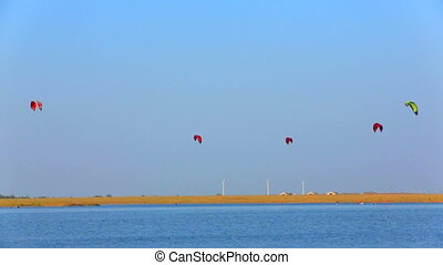 Kites in the sky - Kiteboarders kites soaring above the sea