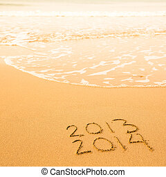 2013 - 2014, written in sand on beach texture, soft wave of the sea.