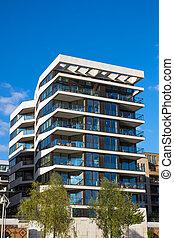 Modern apartment house - A modern apartment house seen in...