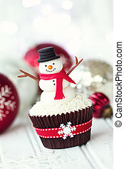 Snowman cupcake - Cupcake decorated with a fondant snowman