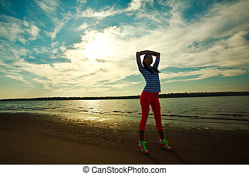 Woman, exercise on the beach - Young slim woman, exercise on...