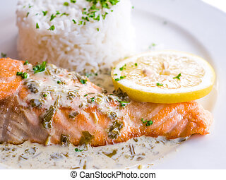 grilled salmon and rice-french cuisine dish with lemon and...