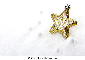 gold christmas bauble as christmas star on snow
