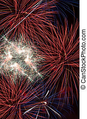 Fireworks in the night sky - Colorful red fireworks in the...