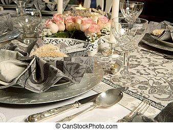 Ornate christmas dinner table with decorated napkins