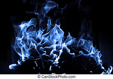 Blue flame isolated on dark background