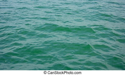 Surface of the calm ocean with small waves