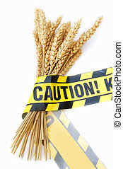 Gluten free diet - Caution tape wrapped around a bundle of...