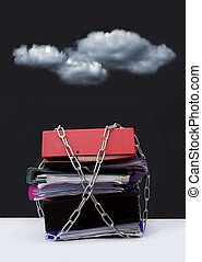 Office stress - Dark clouds hovering over a pile of chained...