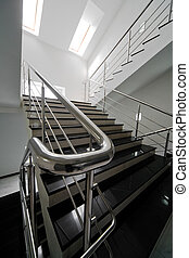 Marble staircase with a steel handrail in a modern building