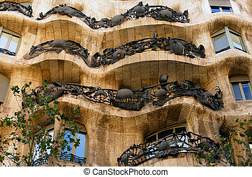 Casa Mila also called La Pedrera by Antoni Gaudi - faade -...