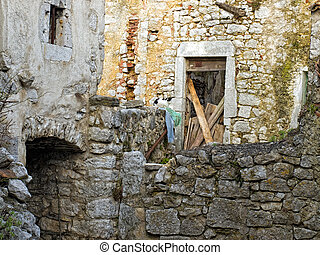 Cat and ruins - Stone ruins of an abandoned Mediterranean...
