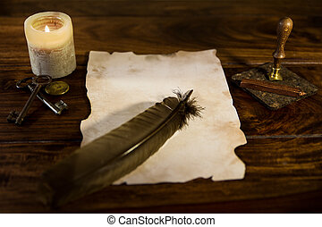 Empty parchment document with feather - an empty parchment...