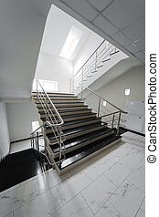 staircase with a steel handrail - Marble staircase with a...
