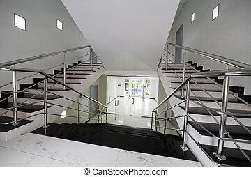 marble staircase - Glass doors with a kind on a marble...