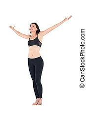 Full length of a sporty woman with hands outstretched over...