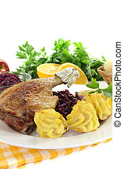 hot Duck leg with red cabbage - hot Duck leg with duchess...