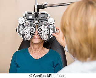 Senior Woman Having Eye Test - Female ophthalmologist using...