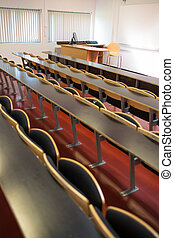 Empty seats with tables in a lecture