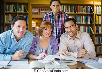 Adult students studying together in - Portrait of four...