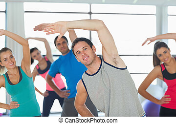 People doing power fitness exercise at yoga class - Portrait...