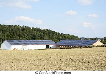 Innovative Farm - Barn of a farm with solar panels on the...