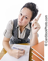 strict teacher pointing finger while marking students work
