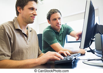 Teacher and mature student in computer room - Smiling...