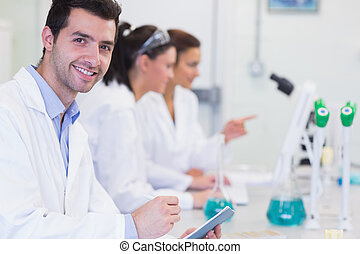 Researchers working on experiments in the laboratory -...