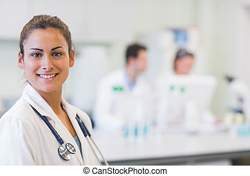 Close-up portrait of confident doctor at medical office -...