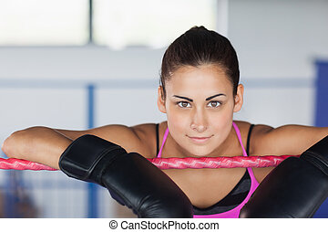 Beautiful young woman in black boxing gloves - Close-up...