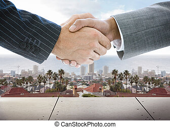 Business handshake on background of townscape - Close-up of...