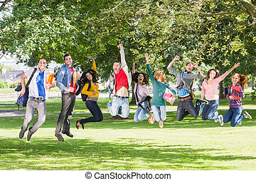 College students jumping in the park