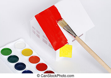 House painting - Watercolour set lying near papery house...