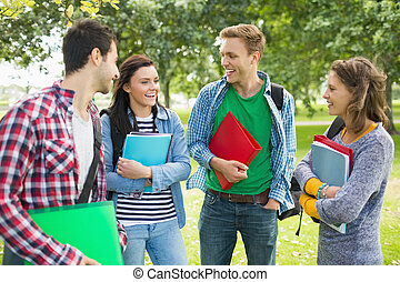 Cheerful young college students in