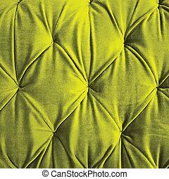 Green button-tufted velvet background