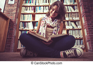 Happy female student against books - Full length of a happy...
