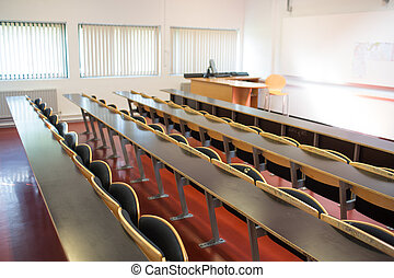 Empty seats with tables in a lecture hall - View of empty...
