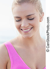 Close up of a smiling healthy woman