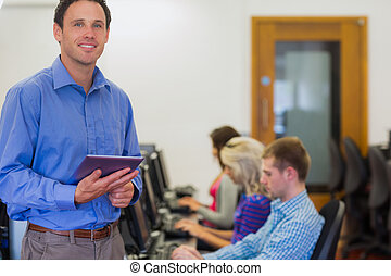 Teacher with students using compute - Portrait of a smiling...
