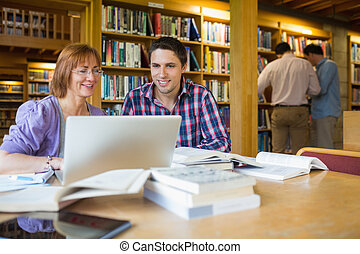 Mature students in the library - Mature students using...