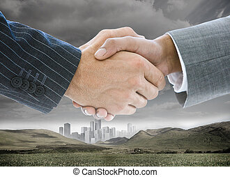 Business handshake on background of buildings and landscape...