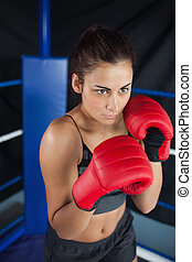 Determined woman in red boxing gloves - Determined young...