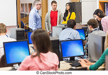 Teacher and students in the computer room