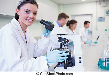 Researchers working on experiments in the lab