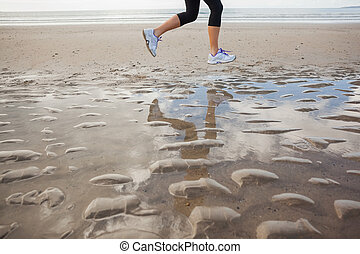 Low section of a healthy woman jogg - Low section of a...